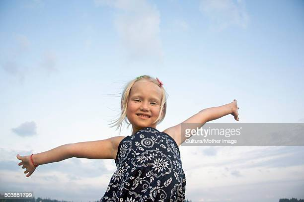 Little girl with out stretched arms