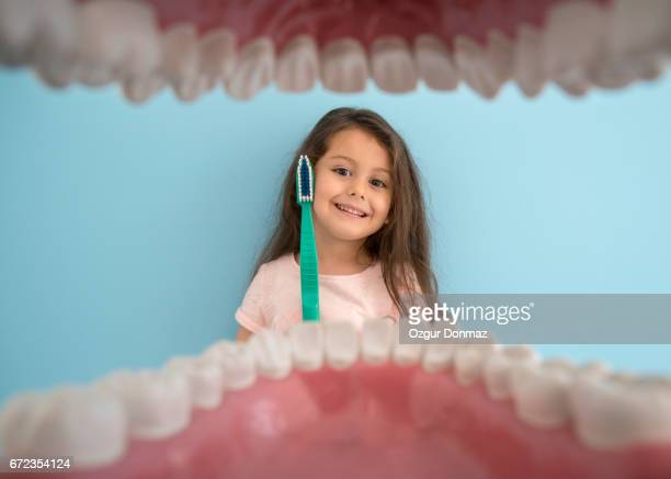 Little girl with oversized toothbrush
