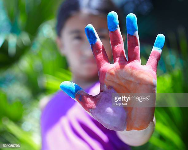 Little girl with painted hand