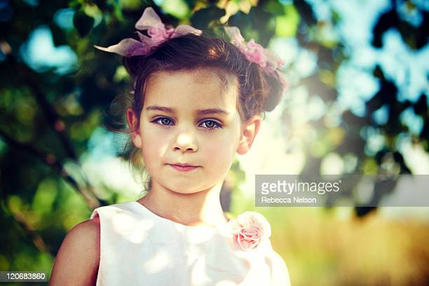 little girl with pig tails on sunny summer day - rebecca nelson stock pictures, royalty-free photos & images