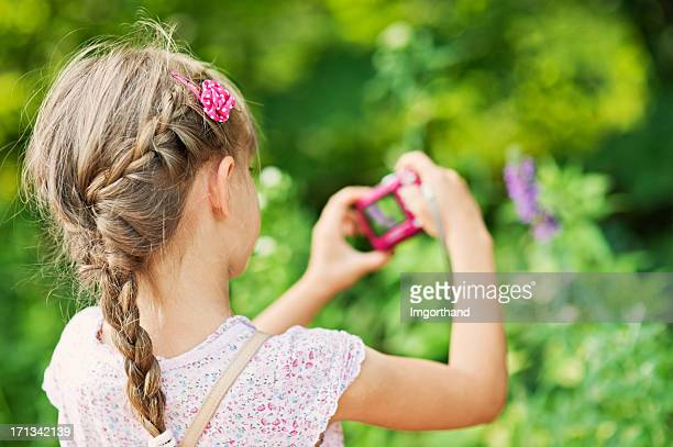 Little girl with pink camera