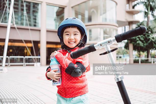 Little girl with protective gears smiling joyfully