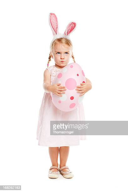 Little girl with rabbit ears and easter egg