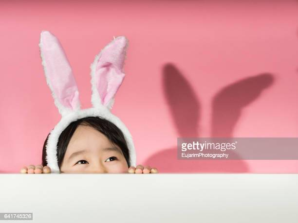 little girl with rabbit ears headband - easter stock pictures, royalty-free photos & images