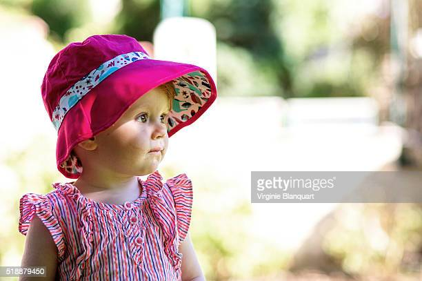 Little girl with red hair enjoying a bountiful summer