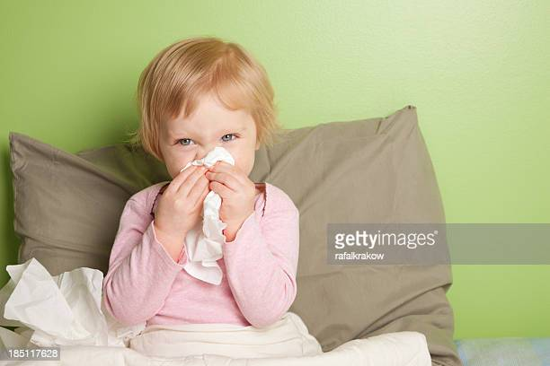 little girl with runny nose - cold virus stock pictures, royalty-free photos & images