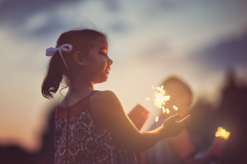 Little girl with sparkler - gettyimageskorea