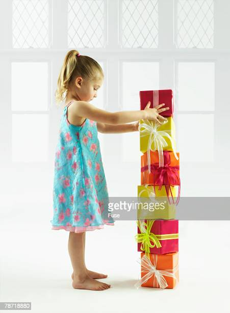 Little Girl with Stack of Presents
