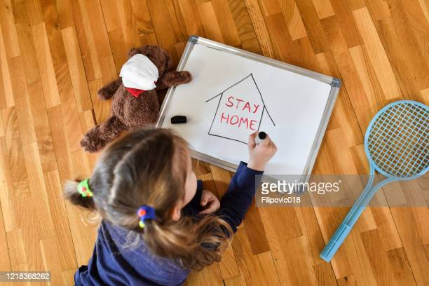 little girl with stay home draw message - shielding stock pictures, royalty-free photos & images