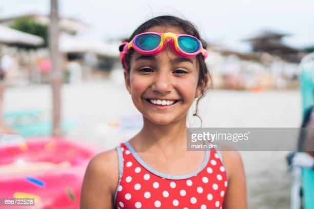 little girl with swimming googles looking at camera - swimming goggles stock pictures, royalty-free photos & images