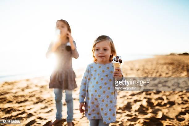 little girl with the icecream on the beach