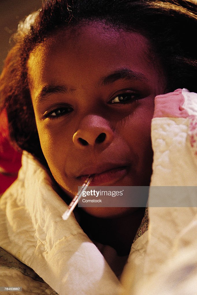 Little girl with thermometer in mouth : Stockfoto
