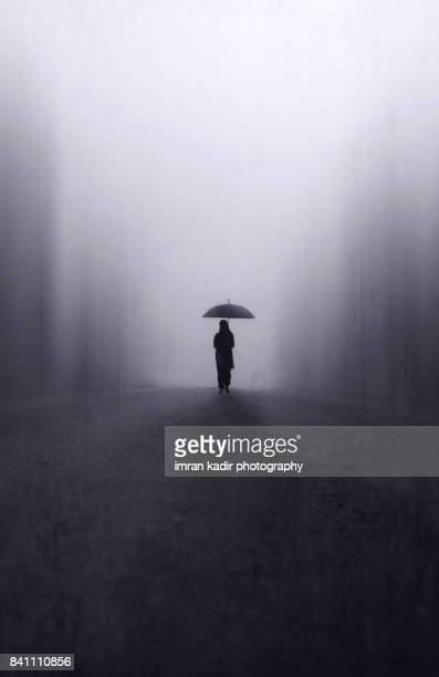 little girl with umbrella on the road - stranger stock photos and pictures