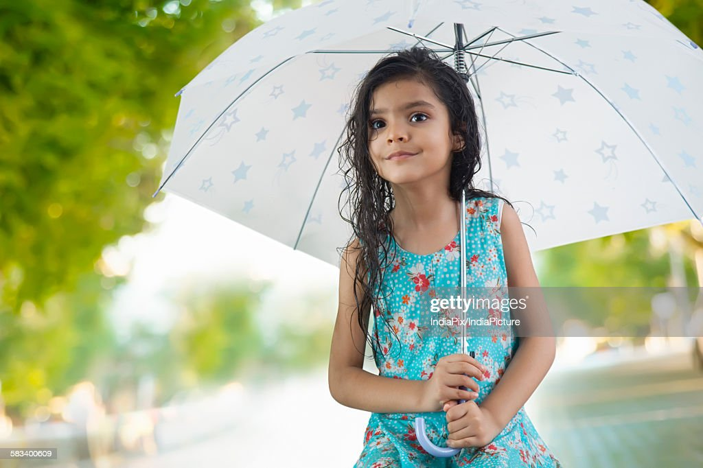 Little girl with umbrella : Stock Photo