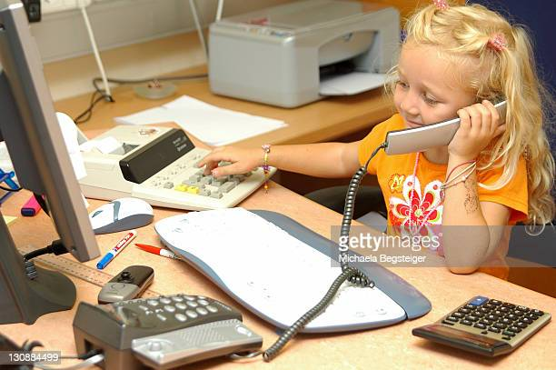 little girl working in office - junior girl models stock pictures, royalty-free photos & images