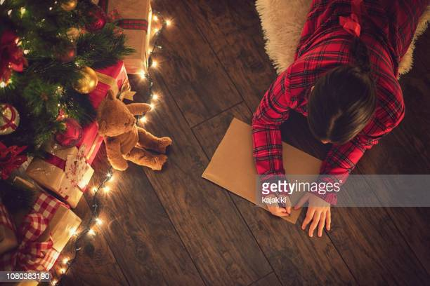 little girl writing a letter to santa claus - list stock pictures, royalty-free photos & images
