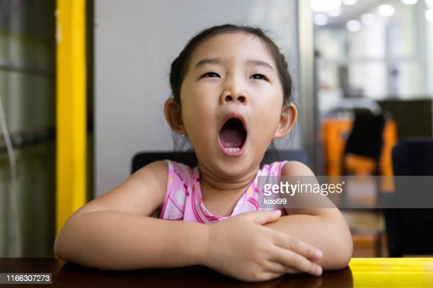 little girl yawning - yawning stock pictures, royalty-free photos & images