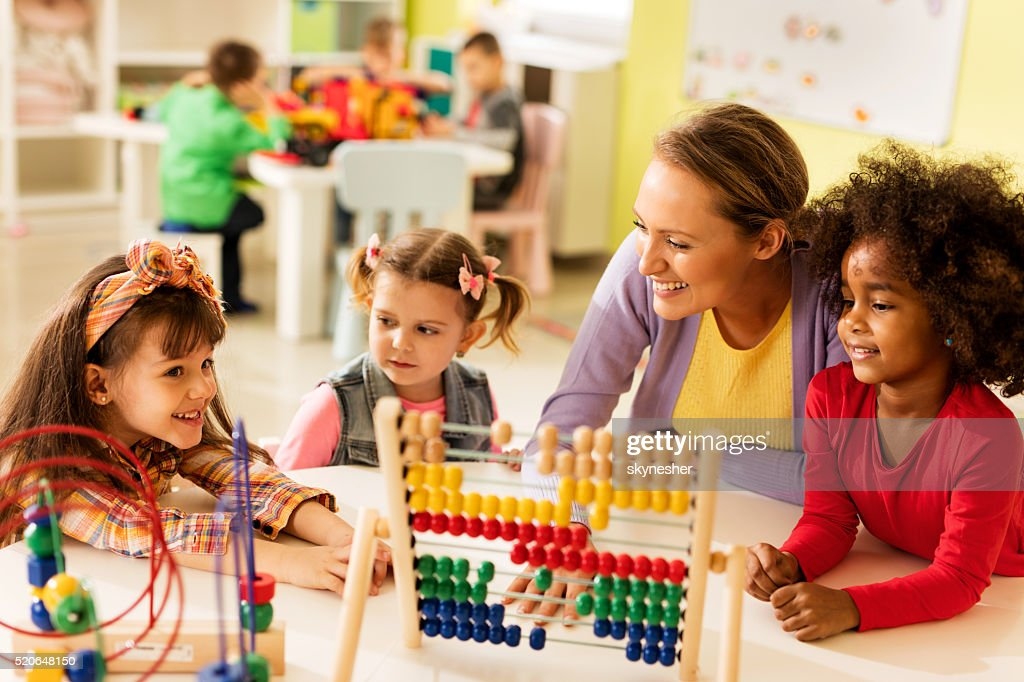 Little girls and teacher learning at preschool. : Stock Photo