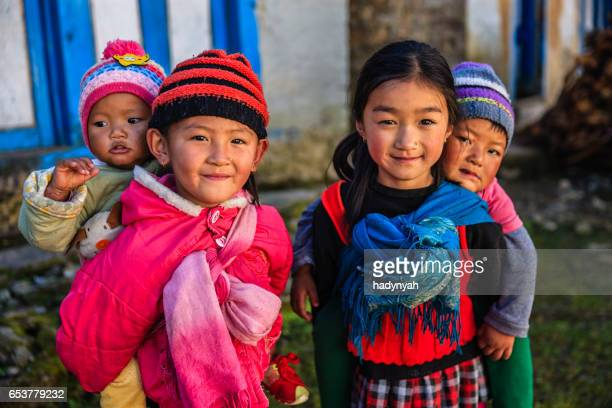 Little girls carrying babies on the back, Solukhumbu, Nepal