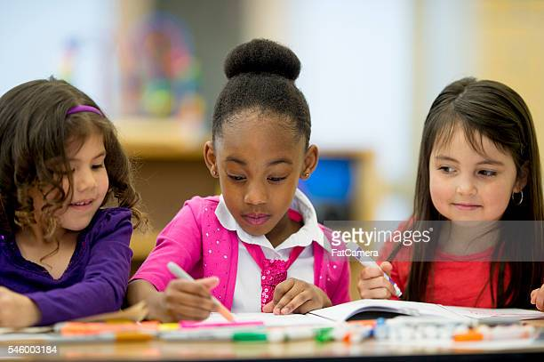 Little Girls Coloring Together