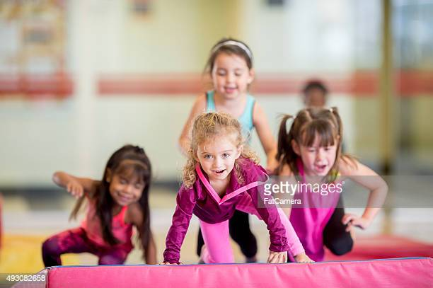 Little Girls Doing a Gym Obstacle Course