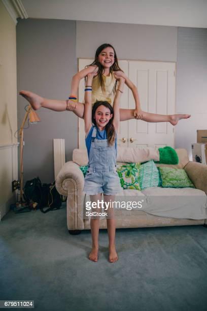 Little Girls Doing Gymnastics at Home