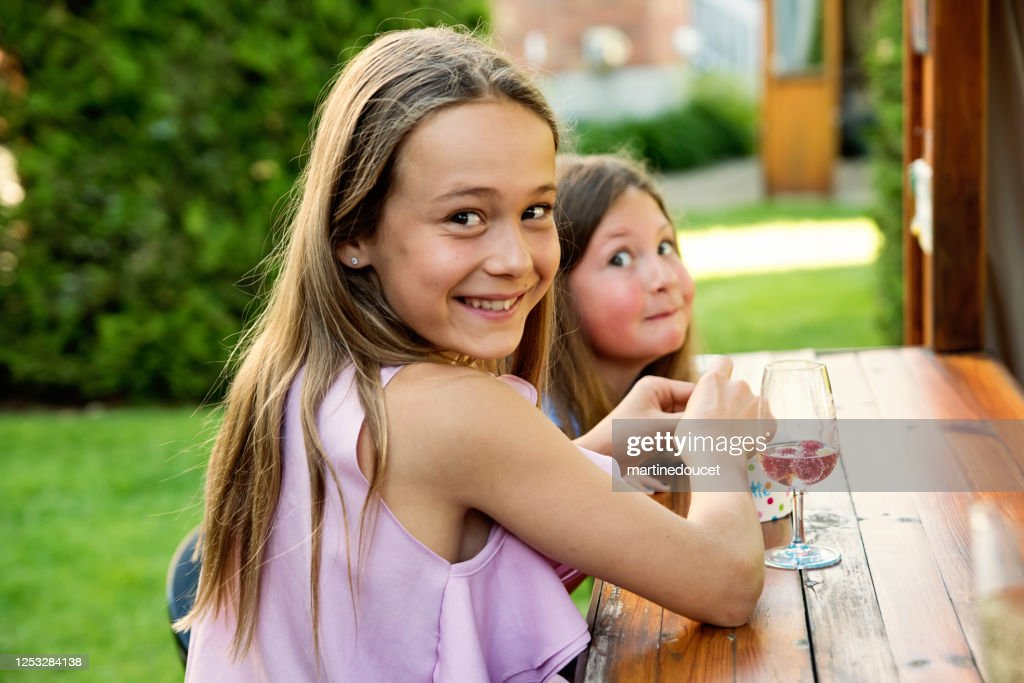 Little girls eating candy at party in backyard. : Stock Photo