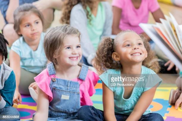 Little girls enjoy story time during after school program