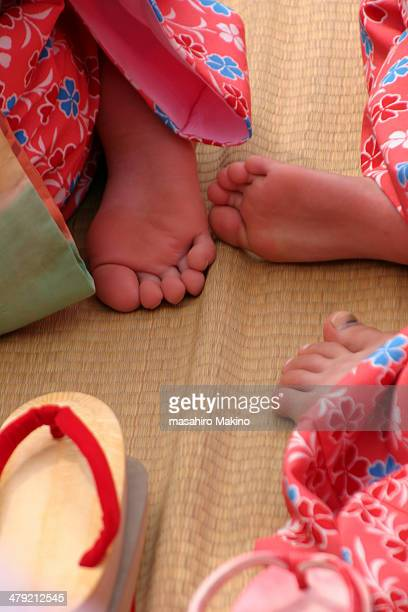 little girls' feet in kimono - little girl soles stock photos and pictures