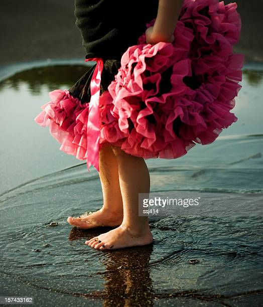 Little Girls Feet Splashing and Dancing in Puddle
