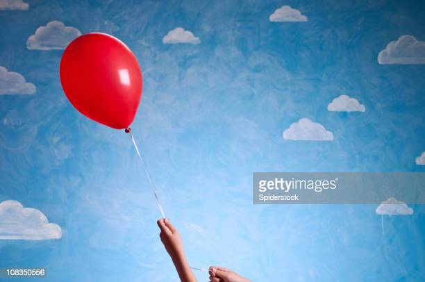 Little Girl's Hand With Red Baloon