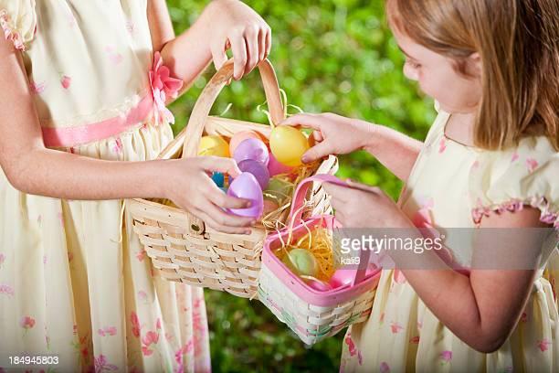 Little girls holding Easter egg baskets