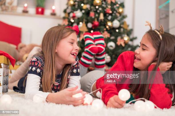 Little girls in front of a Christmas tree