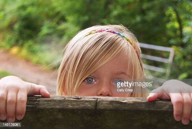 Little girls looking over fence