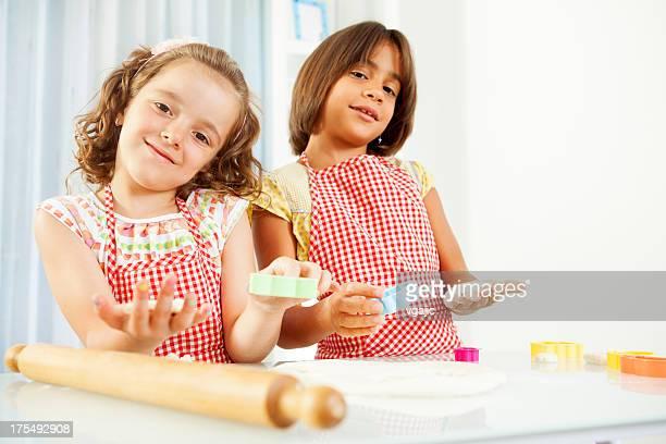Little Girls Making Cookies.