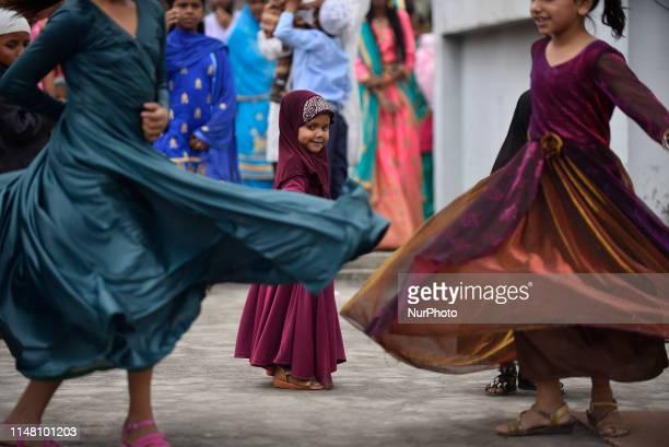 Little Girls playing after offering ritual morning prayers during Eid alFitr celebrated at Kashmiri Takiya Jame mosque at Kathmandu Nepal on...