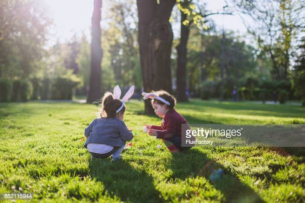 Little girls playing on grass