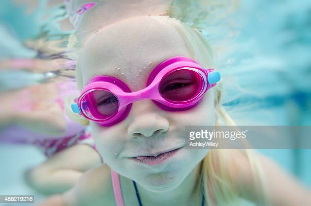 Little girls playing underwater