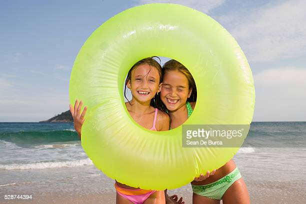 Little Girls Playing with a Life Ring