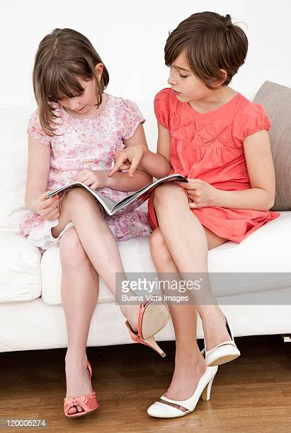 little girls posing like women - little girl in high heels stock photos and pictures