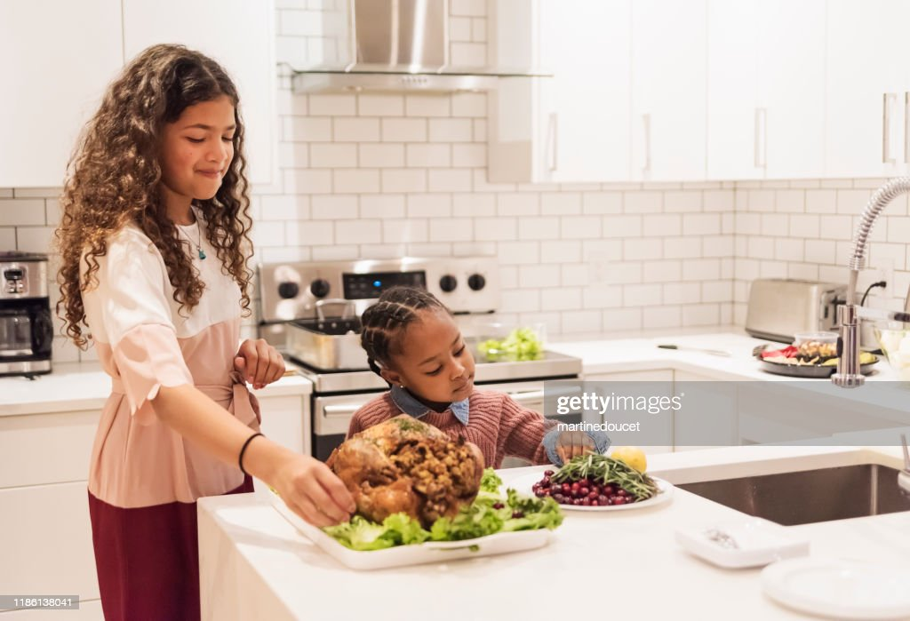 Little girls preparing Thanksgiving dinner. : Stock Photo