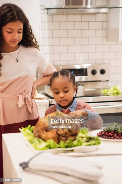 """little girls preparing thanksgiving dinner. - """"martine doucet"""" or martinedoucet stock pictures, royalty-free photos & images"""
