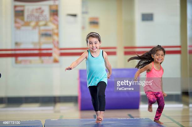 little girls running on gymnastics mats - gymnastics stock pictures, royalty-free photos & images