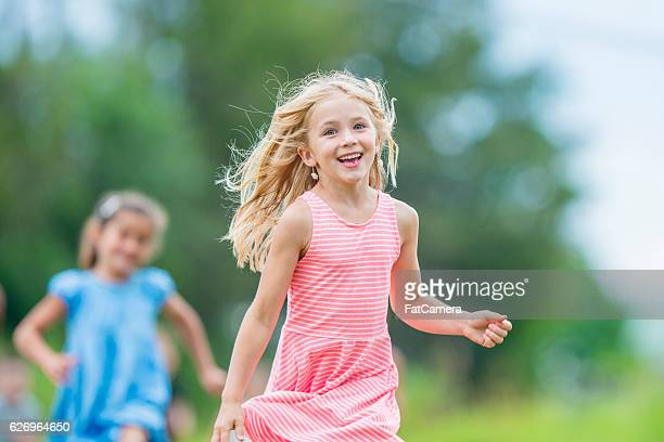 little girls running outside - kids playing tag stock photos and pictures
