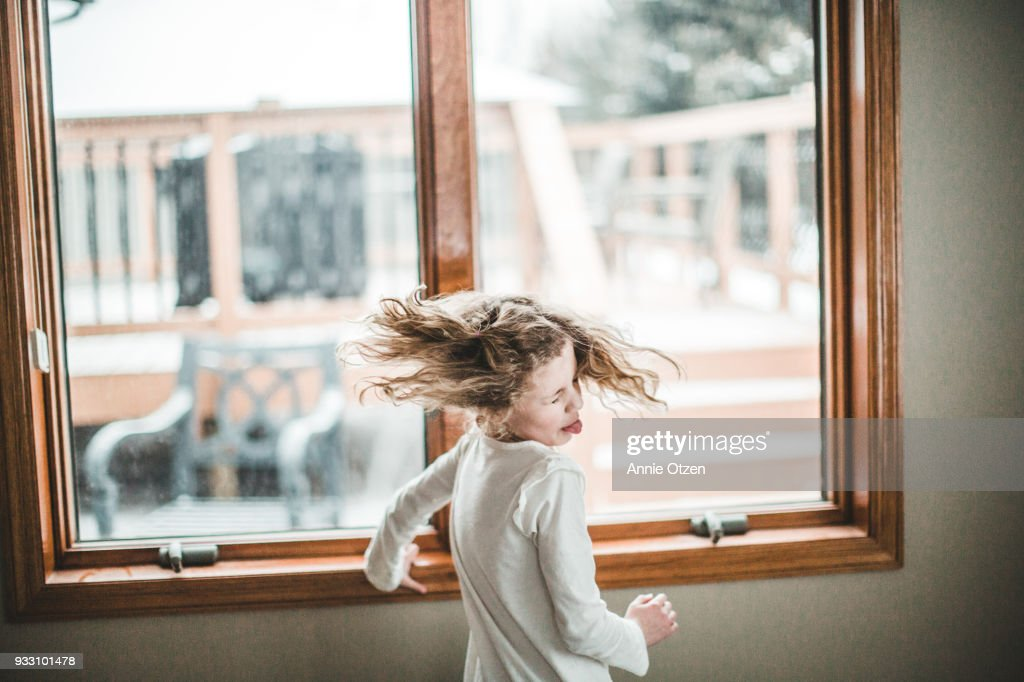 Little Girls Spinning and Shaking her Hair : Stock Photo