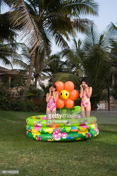 Little Girls Standing in Wading Pool