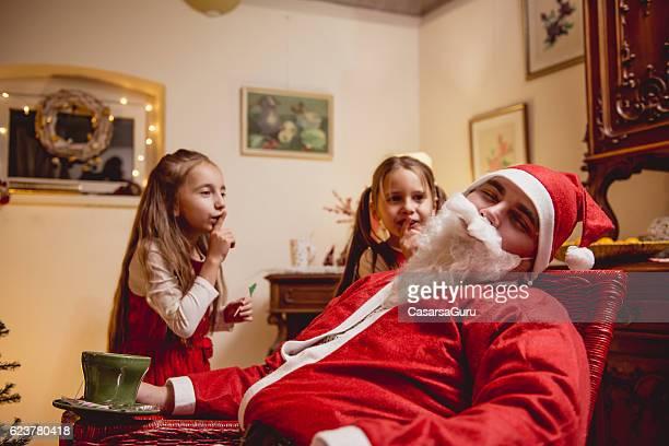 Little Girls Teasing Sleeping Santa