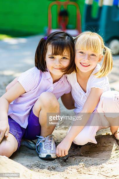 little girls together on the playground best friends forever - mlenny stock pictures, royalty-free photos & images