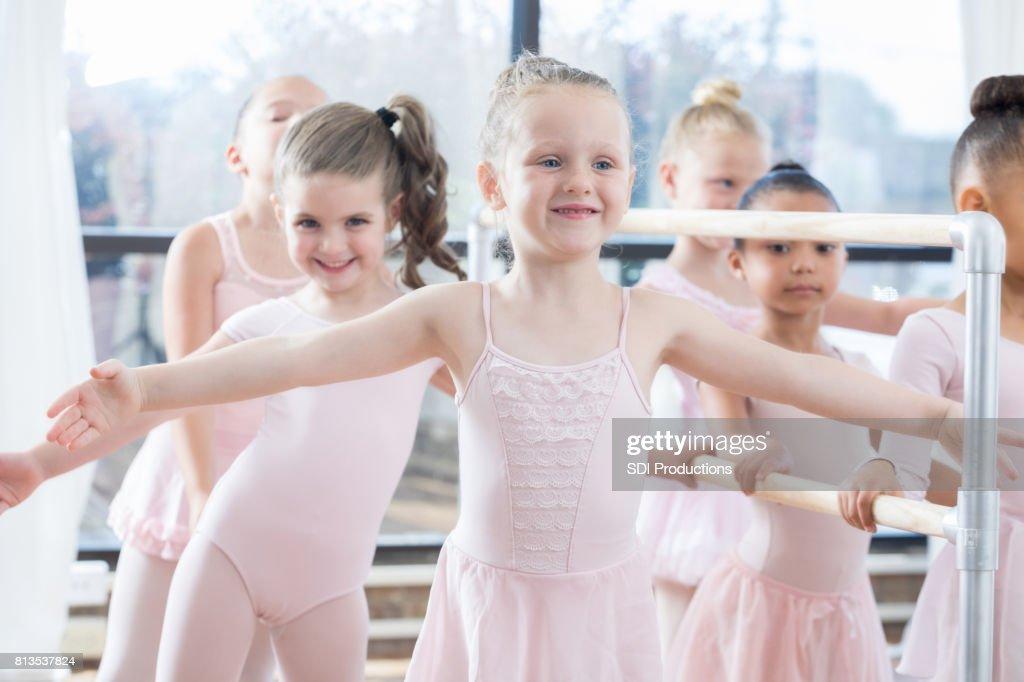 2161673dfccc Little Girls Warm Up Before Ballet Class Stock Photo