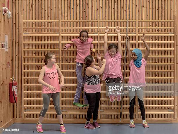 Little girls warm up during a handball training session organised by The Skolidrottsforbundet to help on the integration of migrants through sport...